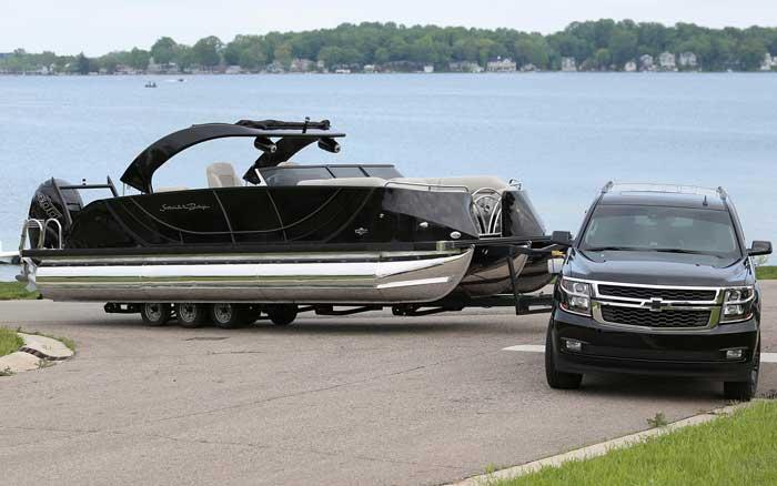 SUV pulling a pontoon boat